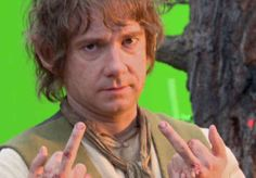 The 'why am I still working' shot. | The 21 Most Glorious Photos Of Bilbo Baggins Giving The Finger. Martin Freeman's personal gang sign?