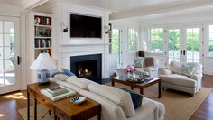 Traditional Living Room with Box ceiling, Wainscoting, Rejuvenation keystick wall sconce, French doors, Wall sconce