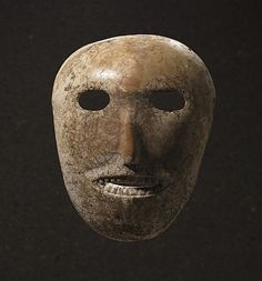 9,000 year old Limestone Neolithic Mask from the Nahal Hemar Cave site in the hills of the Judean Desert, Israel.