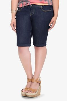 We've taken the Bermuda silhouette straight off of the runway and designed a sleek cuffed jean short that you'll love. Prominent gold and beige stitching adds eye-catching contrast to the dark indigo denim. Modest Shorts, Plus Size Women, Torrid, Plus Size Fashion, Jean Shorts, Indigo, Bermuda Shorts, Girly, Denim