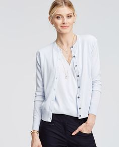 Meet our instant wardrobe icon, the Ann Cardigan. Luxuriously tailored in a super soft blend, this indispensable favorite comes in an array of rich, refined colors and prints that are endlessly chic. Crew neck. Long sleeves. Button front. Ribbed neckline, cuffs and hem.