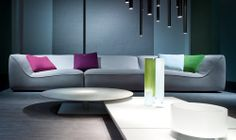Paola Lenti  design: Francesco Rota - Modular sofa composed of corner elements, central elements with different depths and poufs.
