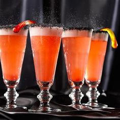 "Orange Hocus Pocus Fizz  Leave out the rum for a virgin ""mocktail"" all your little ghouls and goblins can enjoy."