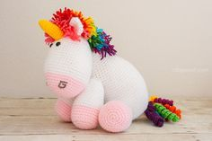 Who wouldn't want this adorable and colorful crochet unicorn? Free pattern too! | www.1dogwoof.com
