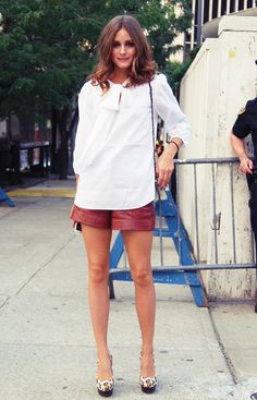 leather shorts, white top. simple