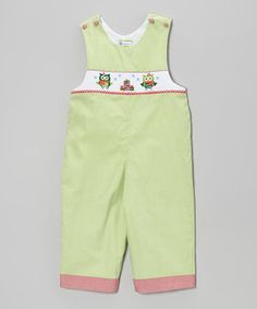 Forget waiting for the holidays to come because these overalls' party of polka dots, sweet smocking and merry embroidery will add festive flair into everyday wear. Thanks to buttons on the shoulder straps, it slips on in just seconds.