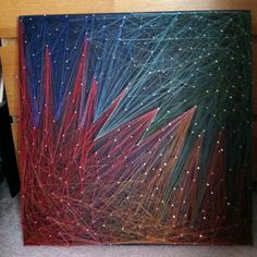 String art, 2'x2'. Thread, nails and plywood