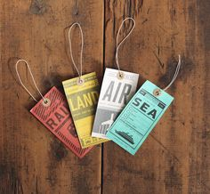 Set of four double-sided tags: air, rail, land, sea. Printed on almost indestructible Tyvek®, a 1950s miracle product that looks like paper but resists tears and water.
