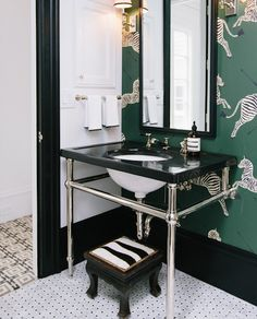 Isn't this the cutest?  Love the zebra on the step stool next to the Scalamandre wallpaper.