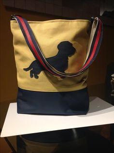 borsa di stoffa e pelle con applicazioni in pelle