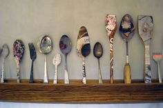 reclaimed wood, vintage spoons, newspaper...great idea to decorate the kitchen!  elisa werbler   Coffee Shop