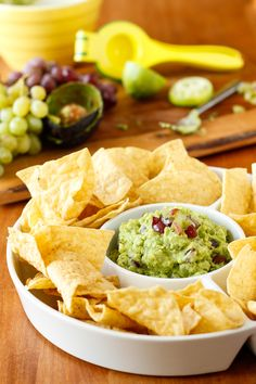 Simple Guacamole Recipe -- this simple and easy homemade guacamole recipe is delicious as is, or add in your choice of mix-ins to kick it up a notch. My favorite add-in? Diced fresh red and green grapes! Seriously, try it...