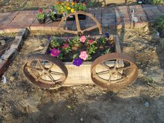 Nifty flower box I made from an old feed trough and some old farm equipment wheels all found in the barns.