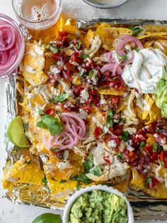 These smoky grilled chicken nachos are thrown on the grill with lots of melty cheddar, to-die-for chipotle ranch and toppings galore. My faves are quick pico de gallo, guacamole and pickled onions. Perfect snack food!