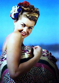 Esther Williams with patriotic flowers in her hair