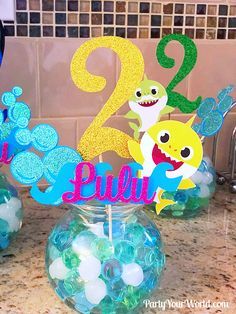 Baby Shark Party Decorations – Centerpieces with Name and Age – - Baby Shower Party Decorations 2nd Birthday Party For Girl, Shark Birthday Cakes, Baby Party, Birthday Ideas, Princess Birthday, Baby Hai, Shark Party Decorations, Birthday Party Centerpieces, Tangled Party