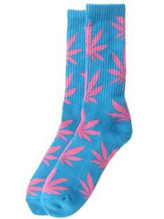 Chaussette HUF - Plantlife socks de chez Huf couleur bleue avec logo plantlife rose.