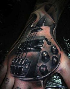 This bass is rather handy to have around. #InkedMagazine #bass #hand #tattoo #tattoos #inked #ink #art