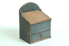 American Hanging Box 19th Century Pine. Slant lift lid and single drawer with divided interior.  Layers of blue paint has wear. Garths