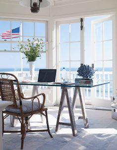 DAVID TSAY  BackNext  View Larger View Thumbnails  Ocean View    Designer Carolyn Espley-Miller decorated her Carpinteria, California home with a clean, crisp style. Her office is surrounded by windows, giving her an incredible view of the ocean.