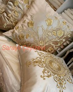 Image may contain: 1 person, indoor Cushion Embroidery, Hand Embroidery Flowers, Gold Embroidery, Machine Embroidery Patterns, Embroidery Designs, Indian Bedroom Design, Designer Bed Sheets, Butterfly Pillow, Pillow Crafts
