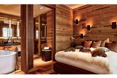 rustic chic at it's finest... textured blankets, layered wood paneling + earth-toned throw pillows