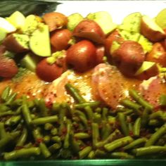 Pork chops covered in Italian dressing 2 cans green beans w bacon bits on top, red potatoes w minced garlic and melted butter and garlic salt cover w foil and bake on 350 for one hour easiest ever!!