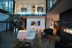 Beautiful glass house on Raymar Place, a short cul de sac in Old Oakville, designed by Jonathan Furlong.