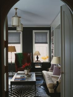 Dark gray walls with white trim.  Wonder if this rug would work in the foyer?