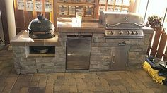 Perfect outdoor cooking...Big Green Egg, Stainless Steel Grill and a place to keep the beers cold!!