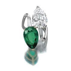 Emerald diamond bypass ring