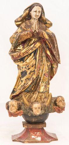 Imagem de madeira policromada, Nossa Senhora da Conceição. Bahia, século XIX. Alt. 28 cm. Vendida 700,00.