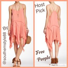Free People fringe coral dress NWT size Medium Just in FREE PEOPLE coral fringe dress NWT size medium. This free flowing dress is an eye catcher. Adjustable straps. 24 inches from armpit to highest part of fringe. Look at size chart I have in my closet please before buying  Free People Dresses Asymmetrical