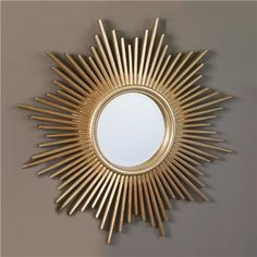 Sunburst Mirror - All hail the Sun King! Bursting with regal style, this mirror is hand finished in Antique Silver with warm highlights to adapt to any decor. Overall Product Dimensions: 36 Inch Diameter Mirror Size: 12 Inch Diameter - $225