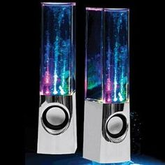 "Plug And Play Muti-Colored Illuminated Dancing Water Speakers All necessary connection cords included. (USB cable and 3.5mm audio cable). Multi-colored water jets make the water dance to the beat. 4 multi-colored LEDs create an incredible light show w/black base. Speakers stand 9"" tall and are compatible with any audio device that has a 3.5mm audio jack connection.. Take your music and sound to another dimension!."