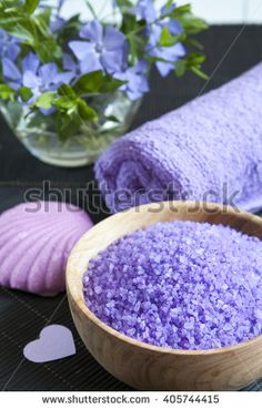 Spa products. Lavender bath salts with flowers, soap and towel. Violet purple concept