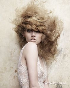 Fluffy curls with a plaited headband - see more here: http://www.hji.co.uk/image/Alexander-Turnbull-BHA-NE7-qhs31633.html