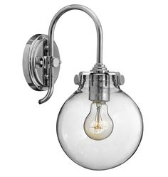 Our Congress Wall Sconce with Clear Globe Shade offers a traditional design that combines hip and historical elements. It features delicate curved armature and coordinates with our Congress Chandelier.  * Available in Chrome, Brushed Caramel and Oil-Rubbed Bronze * Steel, glass * For indoor use * Imported