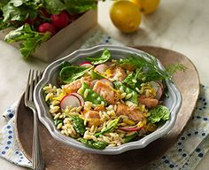 Fresh Atlantic salmon adds perfect protein to this orzo-spinach salad. Radishes bring color and zip, and raisins bring a touch of sweetness.