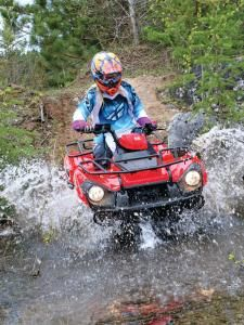 The Brute Force 300 loves to play in the water.  Excellent floor boards drain water away quickly and splash protection from the fenders is very good.  We never had a problem with water entering the CVT or air intake as well.