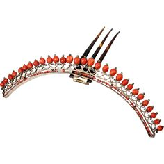 Superb original French Empire tiara with the original comb still attached and all of the large cut red coral beads still mounted. The tinier coral