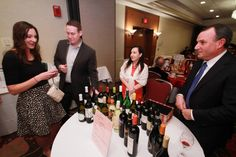 """Angela Lambrecht and Dave Eyrise helping guests decide what """"cork"""" to pull for the Wine Cork Pull. Leukemia And Lymphoma Society, How To Raise Money, Cork, The Voice, Trees, Wine, Fashion, Moda, Fashion Styles"""