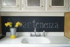 chalkboard paint makes the space under your cabinets a useful area for grocery lists, recipes and love notes.