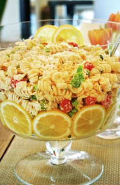 Cold Lemon Pasta Salad:   Ingredients: 1 tablespoon olive oil 2 cloves garlic, minced 1 cup heavy cream 1 cup chicken broth 1-2 lemons (juice and zest) 2 tsp kosher salt 1 tsp black pepper 1 pound pasta 1/2 cup freshly grated Parmesan or Romano cheese –  ½-1 bag of baby arugula – 1 pint grape tomatoes, halved – 1 10 oz package of frozen peas, thawed