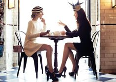 Jane Keltner de Valle and Sheena Smith modeling their Philip Treacy hats