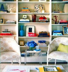 colorful bookcase display + white living room