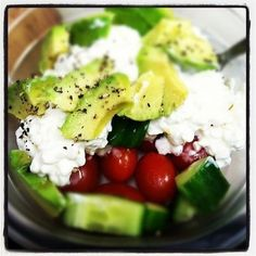 Cottage cheese, avocado, cucumber, grape tomatoes, and cracked black pepper. An easy healthy lunch with protein and phytonutrients!