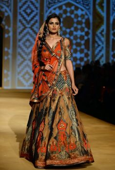 Ashima Leena's 2013 Aamby Valley Bridal collection is not what I would normally expect.  These colors are muted, like the burnt orange and forest green, and aren't embellished to death.  Something truly regal for the bride.    See the whole collection: http://thebigfatindianwedding.com/2013/ashima-leena-at-aamby-valley-bridal-week-delhi-2013/