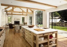 lovely open kitchen with rustic beams and wood floors