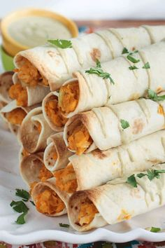 Baked Buffalo Chickpea and Artichoke Vegan Taquitos are the perfect game day food or party appetizer. LET'S PARTY! These spicy buffalo vegan taquitos are meant to be an appetizer or snack, but let's be honest, I could make a meal out of these! The filling is a creamy mixture of smashed chickpeas, chopped artichokes and […] Vegan Recipes Beginner, Best Dinner Recipes, Delicious Vegan Recipes, Cooking Recipes, Yummy Food, Healthy Recipes, Side Recipes, Easy Cooking, Lunch Recipes